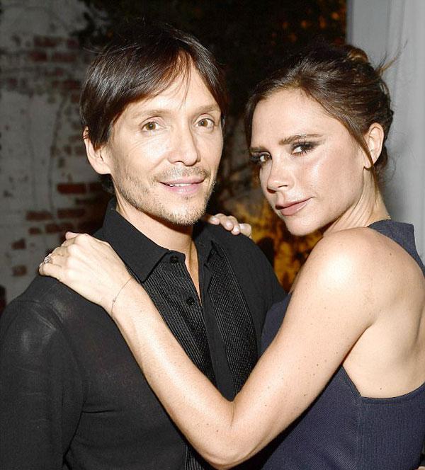 Chụp hình cùng Beckham nhưng Victoria lại ôm eo người đàn ông khác