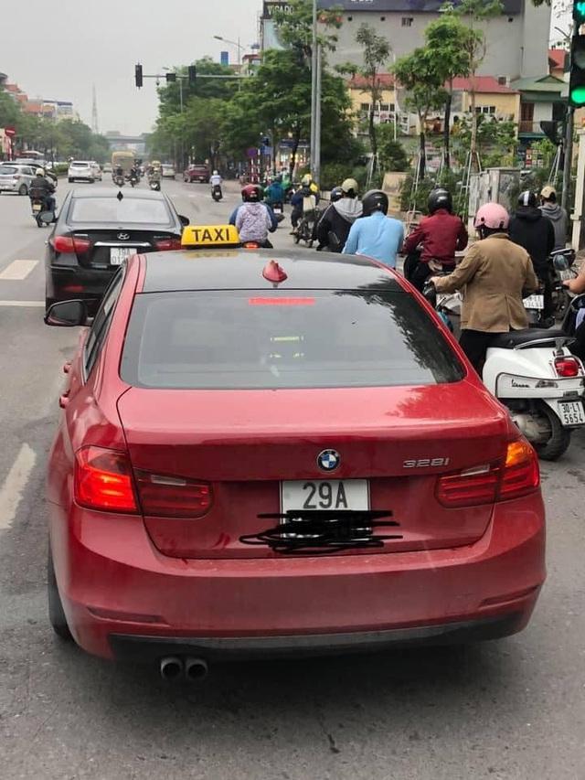 Xe sang BMW tiền tỷ gắn 'mào' taxi chạy tung tăng trên cầu Chương Dương khiến dân mạng xôn xao