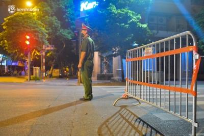 Hà Nội: Người dân 'né chốt', nửa đêm đến hồ Gươm tập thể dục dù công an canh gác xuyên đêm - 2